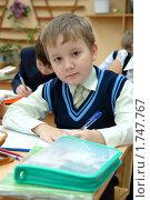 Купить «Ученик за партой», эксклюзивное фото № 1747767, снято 10 декабря 2009 г. (c) Вячеслав Палес / Фотобанк Лори