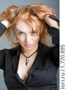 Купить «Сексуальная рыжеволосая девушка», фото № 1770895, снято 9 марта 2010 г. (c) Александр Fanfo / Фотобанк Лори