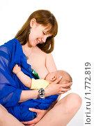 Купить «Кормление ребенка грудью», эксклюзивное фото № 1772819, снято 20 мая 2010 г. (c) Куликова Вероника / Фотобанк Лори