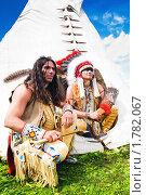 Купить «Индейцы сидят около жилища», фото № 1782067, снято 13 июня 2010 г. (c) Евгений Захаров / Фотобанк Лори