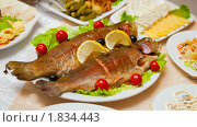 Купить «Блюдо из жареной рыбы - форели на красиво сервированном праздничном столе», фото № 1834443, снято 8 июля 2010 г. (c) pzAxe / Фотобанк Лори