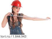 Купить «Девушка с рулеткой», фото № 1844943, снято 28 февраля 2010 г. (c) Александр Маркин / Фотобанк Лори