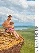 Купить «Отец с ребенком сидят на краю скалы», фото № 1845199, снято 10 июля 2010 г. (c) Типляшина Евгения / Фотобанк Лори