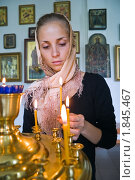 Купить «Девушка ставит свечку в православном храме», фото № 1845467, снято 14 июля 2010 г. (c) Андрей Ярославцев / Фотобанк Лори