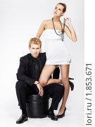 Купить «Молодая пара на сером фоне», фото № 1853671, снято 25 мая 2010 г. (c) Serg Zastavkin / Фотобанк Лори