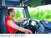Купить «Водитель за рулем грузовика», фото № 1921911, снято 4 апреля 2009 г. (c) Андрей Тирахов / Фотобанк Лори