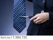 Купить «Девушка режет ножницами  галстук», фото № 1984735, снято 27 августа 2010 г. (c) Денис Миронов / Фотобанк Лори