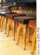Купить «Деревянные табуретки в баре», фото № 2005795, снято 27 июня 2010 г. (c) Наталья Демидчик / Фотобанк Лори