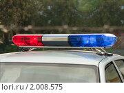 Купить «Специальный сигнал (проблесковый маячок) на крыше патрульной милицейской машины», фото № 2008575, снято 26 сентября 2010 г. (c) Илья Андриянов / Фотобанк Лори