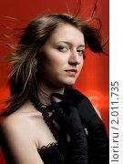Купить «Молодая девушка на красном фоне», фото № 2011735, снято 20 мая 2010 г. (c) Елисей Воврженчик / Фотобанк Лори