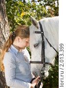Купить «Девушка с лошадью», фото № 2013399, снято 26 сентября 2010 г. (c) Влад Нордвинг / Фотобанк Лори