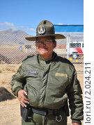 Купить «Женщина-полицейский из Боливии», фото № 2024211, снято 3 сентября 2010 г. (c) Free Wind / Фотобанк Лори