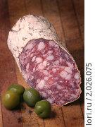 Купить «Копченая колбаса с оливками», фото № 2026075, снято 1 июля 2010 г. (c) Никита Жигелев / Фотобанк Лори
