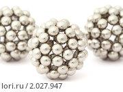 Купить «Три серебристых шара на белом фоне», фото № 2027947, снято 9 февраля 2010 г. (c) Losevsky Pavel / Фотобанк Лори