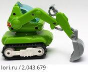 Детская пластиковая игрушка Экскаватор. Стоковое фото, фотограф Максим Сидоров / Фотобанк Лори