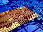Электронная плата с проводниками в виде снежинок. Красно-коричневая основа. Синий фон, эксклюзивная иллюстрация № 2114555 (c) Александр Павлов / Фотобанк Лори