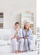 Купить «Девушка переключает пультом телеканал», фото № 2121551, снято 30 сентября 2010 г. (c) Raev Denis / Фотобанк Лори