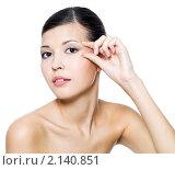 Купить «Красивая девушка трогает кожу под глазами», фото № 2140851, снято 26 октября 2010 г. (c) Валуа Виталий / Фотобанк Лори