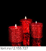 Три свечи на черном фоне. Стоковое фото, фотограф Pshenichka / Фотобанк Лори
