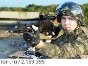 Купить «Снайпер в камуфляже», фото № 2159395, снято 28 июля 2009 г. (c) Сергей Сухоруков / Фотобанк Лори