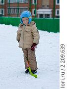Мальчик с клюшкой в руках (2010 год). Редакционное фото, фотограф Евгений Кузьмин / Фотобанк Лори