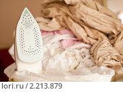 Купить «Утюг с бельем», фото № 2213879, снято 12 декабря 2010 г. (c) Shkurdau Anton / Фотобанк Лори