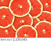 Купить «Фон из грейпфрутовых пластиков», фото № 2230043, снято 27 июня 2019 г. (c) Boroda / Фотобанк Лори