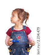 Маленькая девочка с рабочими инструментами. Стоковое фото, фотограф Владислав Зитикис / Фотобанк Лори