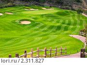 Купить «Живописное зелёное поле для гольфа с деревянным забором», фото № 2311827, снято 24 ноября 2009 г. (c) Иванова Марина / Фотобанк Лори