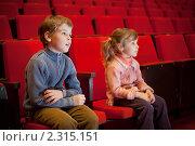 Купить «Мальчик и девочка в кинотеатре», фото № 2315151, снято 22 февраля 2010 г. (c) Losevsky Pavel / Фотобанк Лори
