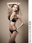 Купить «Молодая сексуальная девушка в купальнике», фото № 2318439, снято 11 июня 2009 г. (c) Евгения Нечаева / Фотобанк Лори