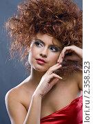 Купить «Портрет красивой девушки в красном платье», фото № 2358523, снято 27 октября 2010 г. (c) Анатолий Типляшин / Фотобанк Лори