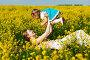 Счастливая мама с дочкой в поле желтых цветов, фото № 2375403, снято 15 мая 2010 г. (c) Podvysotskiy Roman / Фотобанк Лори