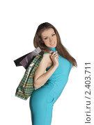 Купить «Девушка с покупками», фото № 2403711, снято 12 февраля 2011 г. (c) Черников Роман / Фотобанк Лори