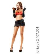 Девушка в мини-юбке с бутылкой виски и сигаретой, фото № 2407351, снято 1 сентября 2009 г. (c) Сергей Сухоруков / Фотобанк Лори