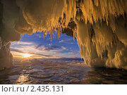 Купить «Байкал. Вид на закат из ледяного грота острова Харанцы», фото № 2435131, снято 26 марта 2011 г. (c) Виктория Катьянова / Фотобанк Лори