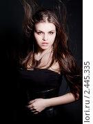 Купить «Портрет девушки с длинными развевающимися волосами», фото № 2445335, снято 19 января 2020 г. (c) Юлия Колтырина / Фотобанк Лори