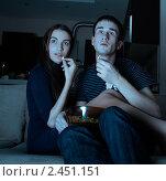 Купить «Молодая пара смотрит фильм дома», фото № 2451151, снято 24 ноября 2009 г. (c) Serg Zastavkin / Фотобанк Лори