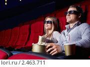 Купить «Молодая пара в кинотеатре», фото № 2463711, снято 1 марта 2011 г. (c) Raev Denis / Фотобанк Лори