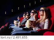Купить «Молодые люди в кинотеатре», фото № 2491655, снято 1 марта 2011 г. (c) Raev Denis / Фотобанк Лори