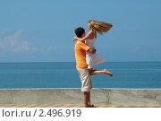 Мужчина и женщина на фоне моря. Стоковое фото, фотограф Иван Полушкин / Фотобанк Лори