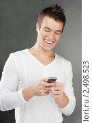 Купить «Молодой человек с мобильным телефоном», фото № 2498523, снято 10 ноября 2010 г. (c) BestPhotoStudio / Фотобанк Лори