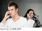 Купить «Юноша и взрослая женщина говорят по телефону», фото № 2498595, снято 10 ноября 2010 г. (c) BestPhotoStudio / Фотобанк Лори
