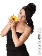 Красивая девушка с цветком орхидея на белом фоне, фото № 2498735, снято 20 апреля 2011 г. (c) Мельников Дмитрий / Фотобанк Лори