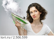 Купить «Красивая девушка с утюгом», фото № 2506599, снято 12 апреля 2011 г. (c) Константин Юганов / Фотобанк Лори