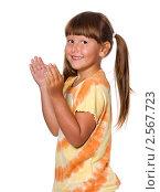 Купить «Весёлая девочка в оранжевом платье», фото № 2567723, снято 27 июня 2010 г. (c) Ольга Сапегина / Фотобанк Лори