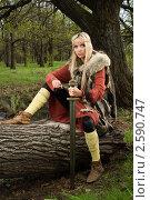 Купить «Девушка-викинг с мечом в лесу», фото № 2590747, снято 11 мая 2011 г. (c) Дмитрий Черевко / Фотобанк Лори