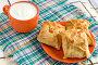 Слоеные пирожки и кружка с молоком, фото № 2594163, снято 14 июня 2011 г. (c) Угоренков Александр / Фотобанк Лори