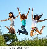Купить «Веселые девушки прыгают на летнем лугу», фото № 2794287, снято 23 июня 2009 г. (c) Иван Михайлов / Фотобанк Лори