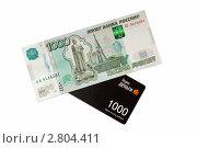 Электронные и реальные деньги, эксклюзивное фото № 2804411, снято 18 сентября 2011 г. (c) Константин Косов / Фотобанк Лори